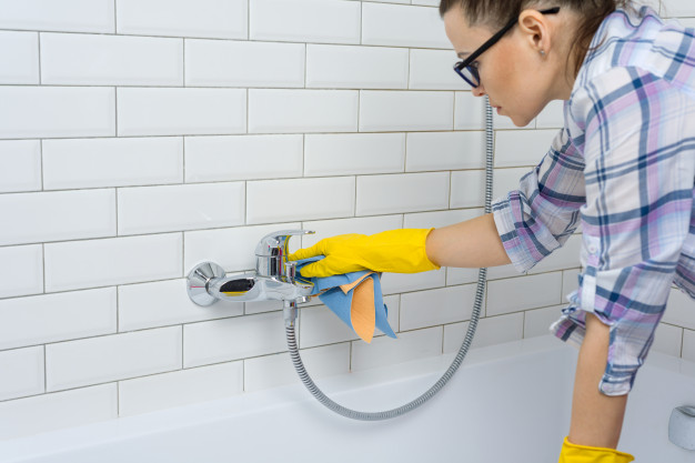 woman-is-cleaning-bathroom-home_116407-2602