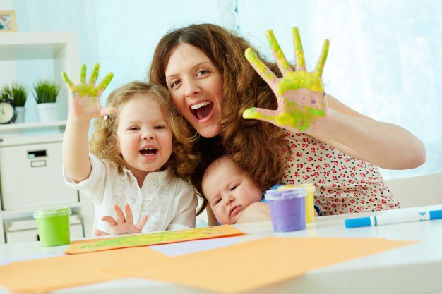 mother-daughter-having-fun-with-paint_1098-1581